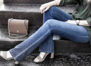 A close up of Erin from Cathedrals and Cafes modeling Diane Gilman DG2 Jeans with Sam Edleman Heels and Tory Burch bag