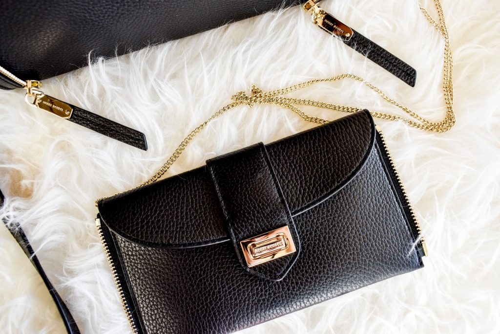 The Rivington Convertible Mini Tote Bag from Henri Bendel with clutch zipped off and chain strap exposed