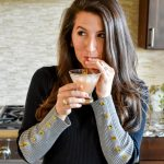 Erin from Cathedrals and Cafes sips a Galentine's Day Cocktail