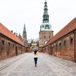 Erin walks a solitary path up to Frederiksborg Castle in Denmark