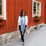 Erin wears a long scarf, her favorite travel wardrobe essential, in Sweden.