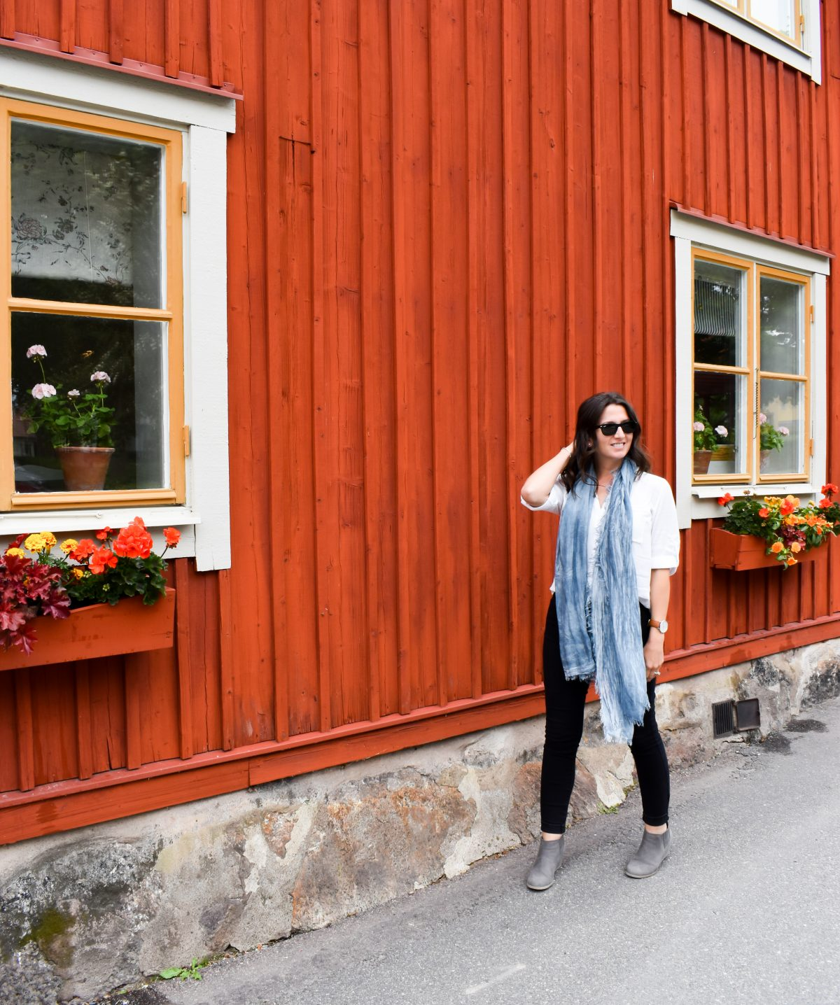 Erin walks along flower boxed in Sigtuna Sweden